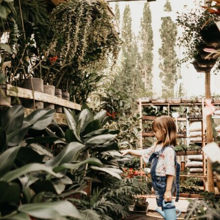 child in green house